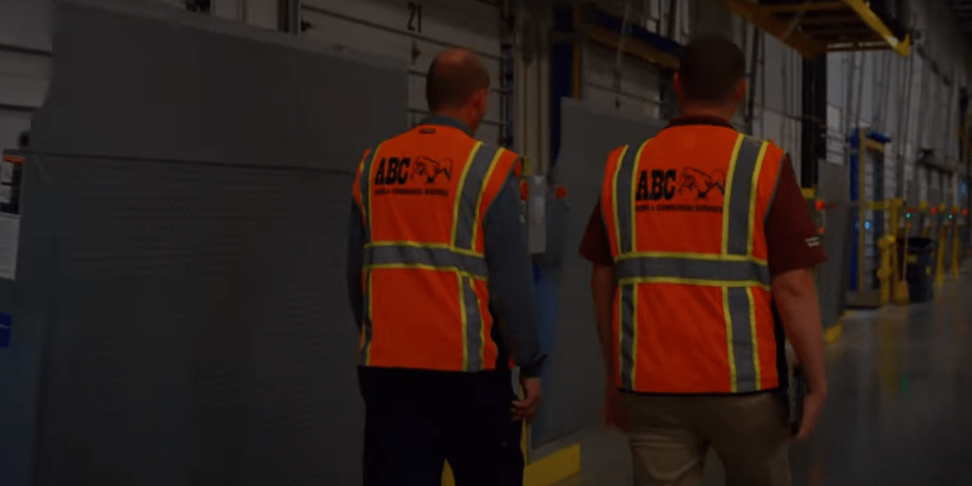 two commercial pest control specialists performing an inspection at a food bank