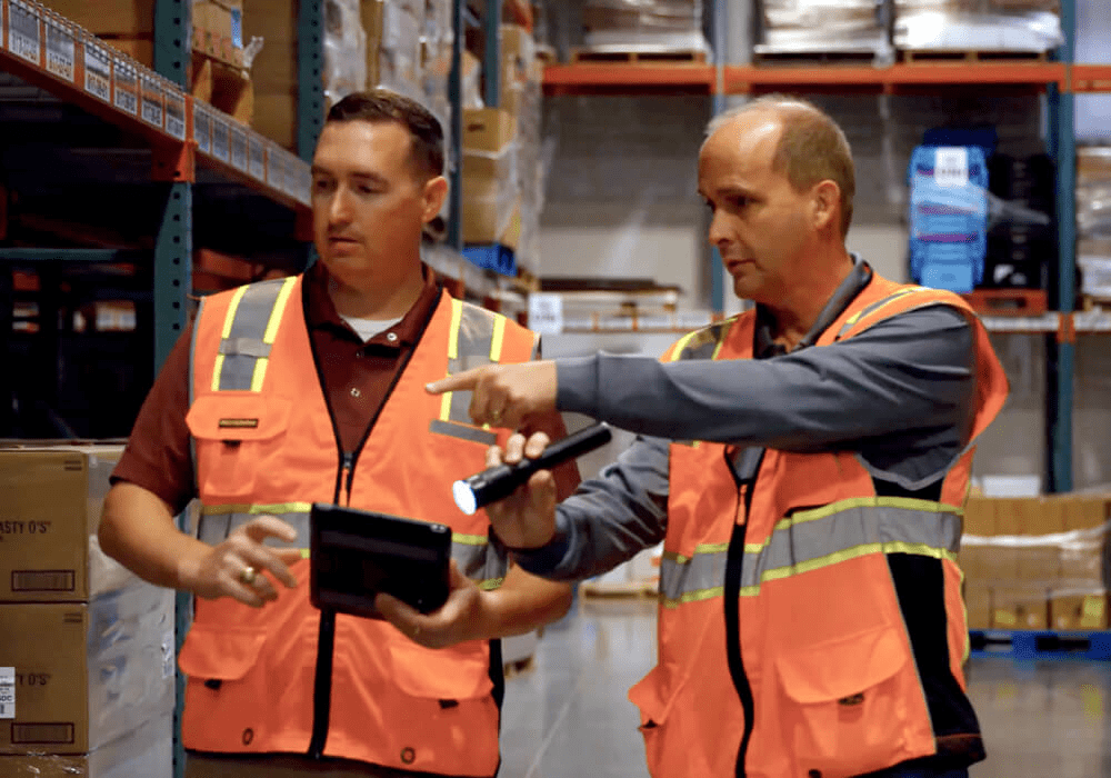 commercial pest control specialists performing an inspection at a food distribution facility