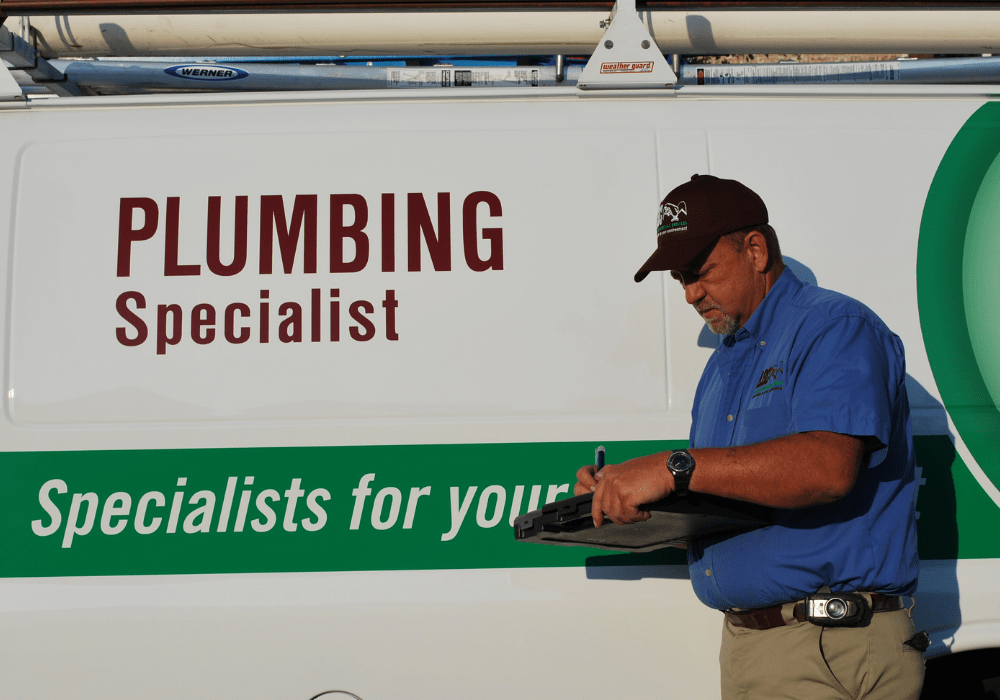 a plumber writing up a report on a plumbing repair for a business