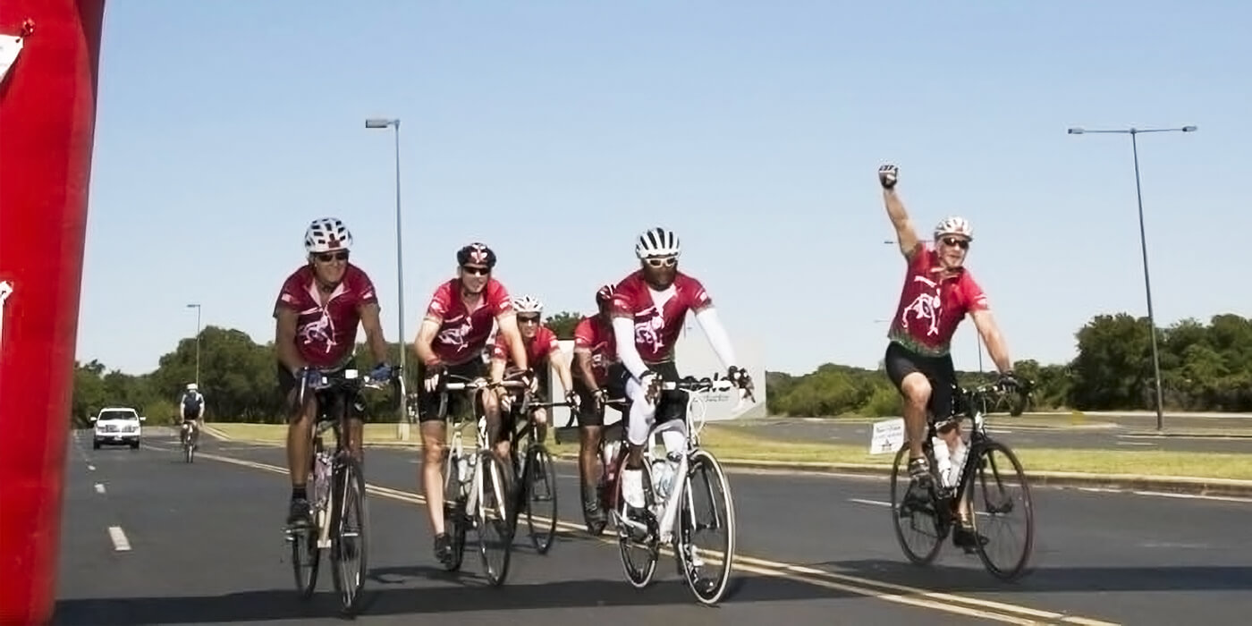 the three Jenkins brother triumphantly biking cross country for charity